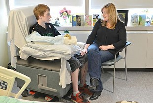 Brett Bouchard sits with his mother in his room at MGH. Photo: Josh Reynolds for The Boston Globe/Pool