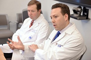 Dr. Curt Cetrulo, left, and Dr. Kyle Eberlin made the difficult decision to try and reattach Bouchard's arm. Photo: Josh Reynolds for The Boston Globe/Pool