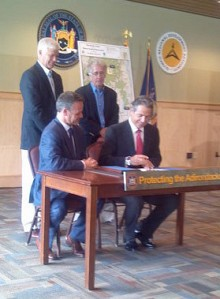 Governor Andrew Cuomo signs contract with Nature Conservancy in Lake Placid. Photo: Brian Mann