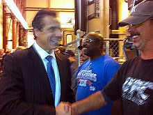 Governor Cuomo shakes hands with Kevin Bushey (front) and Mitchell Graham workers at Bombardier plant in Plattsburgh in 2012. This week, Governor Cuomo cited growth at the Bombardier plant as a sign of economic vitality in the North Country.  Photo: Sarah Harris