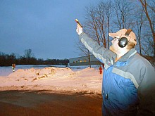 Cody Baciuska, of Loomacres Wildlife Management, fires pyrotechnics into the sky to scare away Watertown's winter crow flock in 2012. Photo: Joanna Richards