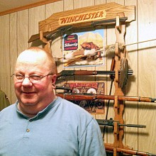 Brian Sherwood in front of his personal gun collection. Photo: Sarah Harris