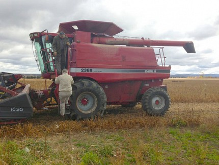 The congressman catches a ride on the combine. Photo: Sarah Harris.