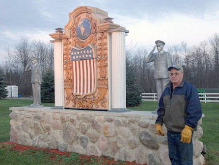 Greg Caron in front of the soldier memorial he designed himself. Photo: Sarah Harris