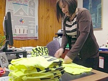 Cora Lee Barrett folds benefit t-shirts for the cause. Photo: David Sommerstein