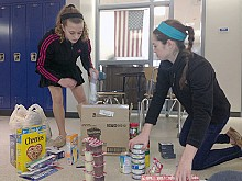 Student volunteers hard at work on the middle school food drive. Photo: Sarah Harris