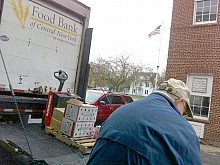 A volunteer unloads packages at the Potsdam Neighborhood Center. It's one of the organizations that receives help from both the Stewart's Shops and Price Chopper programs. File Photo: Zach Hirsch