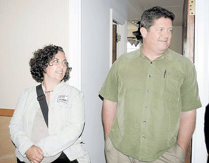 Fred Roedel III, right, of Roedel Companies and Kim Alvarez of Landmark Consulting talk outside a guest room during a tour of the Hotel Saranac. Photo by Chris Knight - Adirondack Daily Enterprise