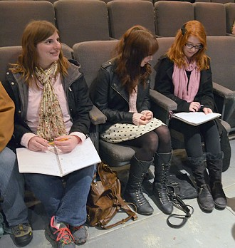 Beekmantown senior Amber Baker, left, and her classmates work on a playwriting assignment during a workshop at Pendragon Theatre.  Photo:  David Zwierankin