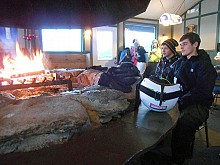 Josh Askins and a friend cozy up to the fire in the clubhouse at Dry Hill Ski Area, Watertown. Photo: Joanna Richards
