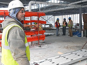 Bart Young, foreman on the construction site, points out the residence hall's features. Photo: Joanna Richards