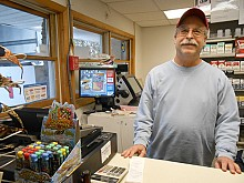 Vince Battista said business at his Sackets Harbor Country Mart, on Dodge Avenue in the village, was up 300 percent from a typical Monday as patrons bought bread, gas and water in preparation for Hurricane Sandy. Photo: Joanna Richards