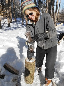 Betsy Kepes uses a wedge to demonstrate a wood splitting technique. Photo: Joanna Richards
