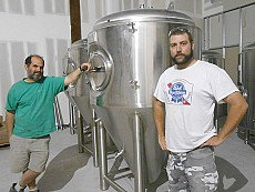 Mark Crandall (left) and Ryan Chaif, co-owners of Skewed Brewing, take a break from working on the business's home-to-be in Watertown's mall the summer before it opened. Despite being a craft-beer lover and brewer, Chaif says he enjoys a Pabst Blue Ribbon or two while doing yardwork. Photo: Joanna Richards
