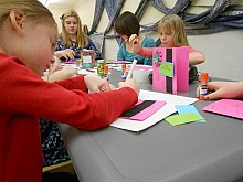 Kids make birthday cards during a day of art workshops at the North Country Arts Council's studio in Watertown. Photo: Joanna Richards