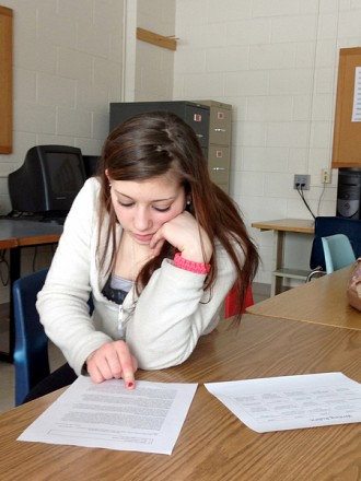 Desiree reading aloud during class. Photo: Sarah Harris