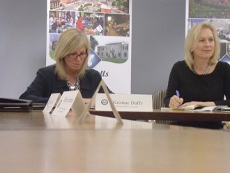 Sen. Kirsten Gillibrand (R) sits with Adirondack Community College president Kristine Duffy. Photo: