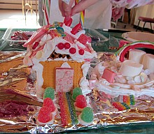 Children had a sweet time, working with cookies and candy on their houses. Photo: Julie Grant