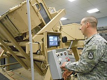 Civilians go for a spin - literally - inside a Humvee rollover simulator. Photo: Joanna Richards