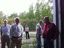 Town of Fine supervisor Mark Hall tells Commissioner Martens about the hazardous J&L buildings. Photo: Zach Hirsch
