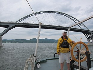 Tom Larsen brings the boat under the Champlain Bridge. Photo: Sarah Harris