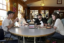 Josh Jones (second from right) talks schoolwork with Tyler Twitchel, Jesse Smith and Josh's girlfriend Danielle Rageotte at lunchtime in the cafetaria. Photo: Mark Kurtz