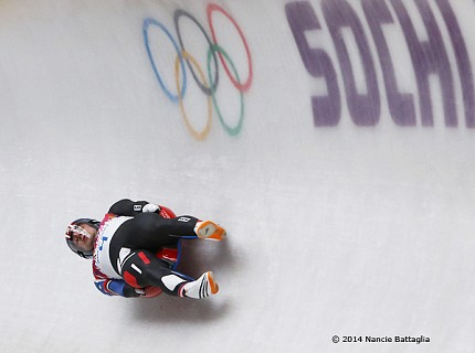 I love this image of Saranac Laker Chris Mazdzer dropping down the Sochi luge track pulling serious Gs.  How does Nancie Battaglia capture that moment?