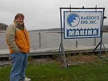 Mike Miller, general manager at Harbor's End Marina on Lake Ontario in Henderson, Jefferson County, says his workers are getting ready for the storm by ensuring boats are properly secured. Photo: Joanna Richards