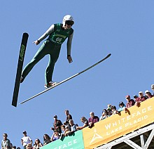 Peter Frenette jumping in Lake Placid. Photo:  Mike Lynch, <em>Adirondack Daily Enteprise</em>