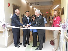 Secretary Shinseki helps hospital officials cut the ribbon symbolizing the grand opening of the new spinal cord wing of the Syracuse VA Medical Center. Photo: Joanna Richards