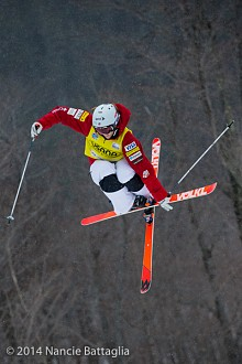 USA's Hannah Kearney grabs her ski during moguls competition at Whiteface Mountain.  Kearney is the World Cup point leader and a gold medal Olympian. Photo:  Nancie Battaglia, NCPR Winter Olympics correspondenet