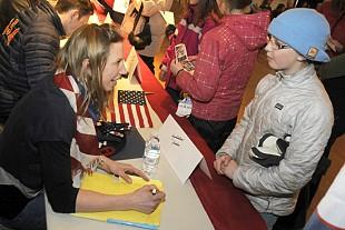 Annelies Cook, a biathlon racer from Saranac Lake, signs autographs.  Photo:  Mark Kurtz