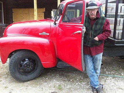 "Bill Knoble with the ""Red Truck."""