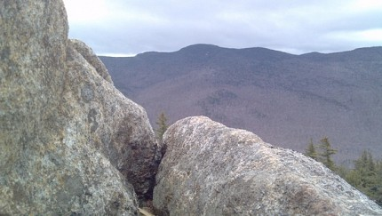 A cleft of rock on the flank of Catamount, with the Sentinel Range visible in the distance. Photo: Brian Mann