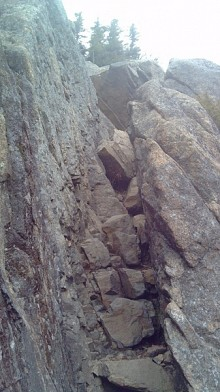 A scree ladder leads hikers up through the rock on Catamount's shoulder. Photo: Brian Mann