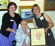 Loretta Lepkowski presents Ceil Buckley with her portrait last May.  Ceil lived to be 100 and her portrait was gifted to the Old Forge Library's Quilting Room.