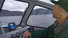 Charlie Andreson, NYSDEC, patrols Lake George after Hurricane Sandy (Photo:  Brian Mann)