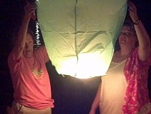 Families launch Chinese lanterns into the night sky.  (Photo:  Brian Mann)