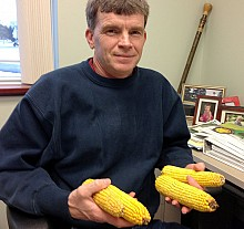 Clark Putman of the Farm Service Agency keeps ears of corn on his desk as a reminder of farmers' high feed costs. Photo: David Sommerstein.
