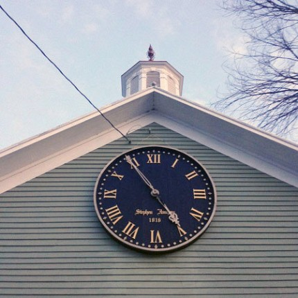The clock was built in 1816. It now hangs on the exterior of Greg Caron's barn. Photo: Sarah Harris