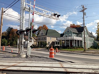 CSX's upgraded and faster rail crossing passes right by dozens of houses in Canton. Photo: David Sommerstein.