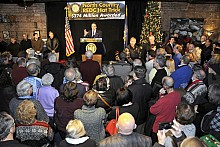 Governor Andrew Cuomo speaks to a packed house at the Downhill Grill earlier this month. The Regional Council process has been great politics.  Is it great economics? (Photo:  Mark Kurtz)