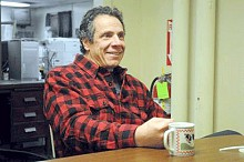 NY Gov. Andrew Cuomo during an interview with an Enterprise reporter at the newspaper's offices over the holidays in Saranac Lake.  The governor wrote his speech while visiting the Adirondacks.  Photo: Mike Lynch, courtesy Adirondack Daily Enterprise
