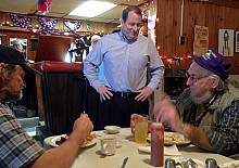 Doheny introduces himself to diners in Dekalb. One of his key challenges: to make sure they like him. Photo: David Sommerstein