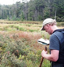Brian Mann measures the miles on the trail to Duck Hole. Photo: Susan Waters