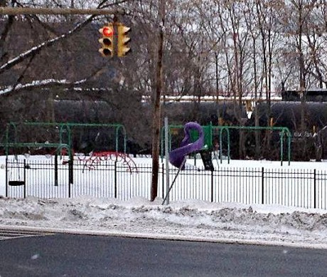 Bakken crude oil train next to children's playground at Ezra Prentince Houses in Albany. Photo by Jenna Flanagan