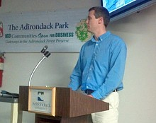 Josh Clague with NYS DEC presents the new tower plan to the APA. Photo: Brian Mann
