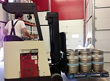 Pierce hauls the kegs to a cooler where they await shipment. Photo: David Sommerstein.