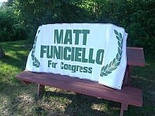 Matt Funiciello campaigned on Friday in Lake Placid, spreading his banner outside a local health food store.  Photo:  Brian Mann