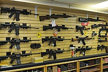 NY already bans high-capacity magazines, such as these displayed on an Arizona gun shop wall. The legislature is now adding assault rifles to the list of banned assault weapons. Photo: Mike Saechang CC some rights reserved